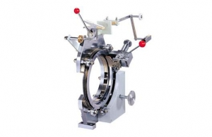 What is the structure of the automatic ring winding machine?